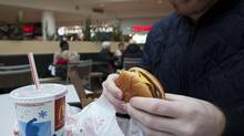 People eat fast food at a food court in Toronto on Feb. 24. (Matthew Sherwood For The Globe and Mail)