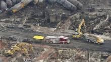 Workers and firefighters work on the remains of downtown Lac-Megantic. REUTERS/Mathieu Belanger (MATHIEU BELANGER/REUTERS)