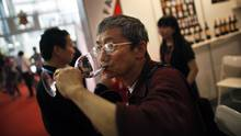 A man drinks red wine during the 6th Shanghai International Wine Trade Fair in 2011. (Carlos Barria/Reuters)