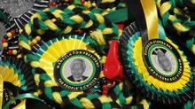 A picture of former South African President Nelson Mandela is seen on memorabilia sold in Bloemfontein Jan. 6, 2012. (SIPHIWE SIBEKO/SIPHIWE SIBEKO/Reuters)