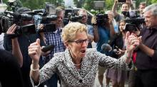Ontario Premier Kathleen Wynne reacts as she greets supporters and staff after winning a majority government at Queen's Park in Toronto on Friday, June 13, 2014. (Nathan Denette/THE CANADIAN PRESS)