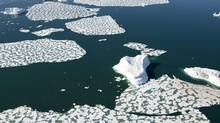 Ice patterns and icebergs are seen in Croaker Bay near Devon Island in Canada's Arctic, Friday, July 11, 2008. (JONATHAN HAYWARD/THE CANADIAN PRESS)