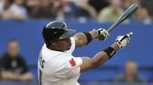 Rajai Davis #11 of the Toronto Blue Jays bats during MLB game action against the Baltimore Orioles July 27, 2011 at Rogers Centre in Toronto. (Brad White/Getty Images)