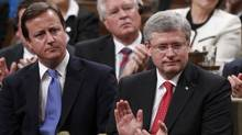 Britain's Prime Minister David Cameron sits with Canadian Prime Minister Stephen Harper after Mr. Cameron addressed a joint session of Parliament in Ottawa Sept. 22, 2011. (BLAIR GABLE)