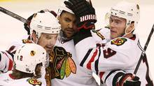 Chicago Blackhawks' Dustin Byfuglien, centre, celebrates his first period goal against the Vancouver Canucks with teammates Duncan Keith, left to right, Patrick Sharp and Jonathan Toews during game 3 NHL western conference playoff hockey action at GM Place in Vancouver, Wednesday, May 5, 2010. (Jonathan Hayward/THE CANADIAN PRESS)