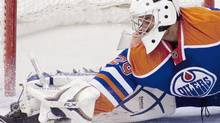 Edmonton Oiler goaltender Martin Gerber makes a save during first period NHL hockey action against the Ottawa Senators in Ottawa on Monday November 29, 2010. (Pawel Dwulit)