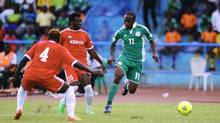 Kenya's David Owino (C) challenges Nigeria's Victor Moses (R) during their 2014 World Cup qualifying soccer match at the U.J Esuene Stadium in Calabar March 23, 2013. (AFOLABI SOTUNDE/REUTERS)