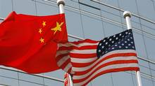 U.S. and Chinese flags wave side by side in Beijing (TEH ENG KOON)