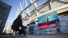 Gerald Joe watches a public livestream of the TED talks outside BC Place in Vancouver, March 17, 2014. (Ben Nelms/The Globe & Mail)