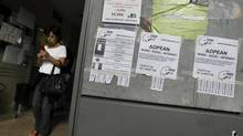 Advertisements for foreign languages and computer lessons are pasted outside an unemployment bureau in Athens October 11, 2012. Greece's jobless rate rose for the 35th consecutive month in July, scaling a new record of 25.1 per cent from an upwardly revised 24.8 percent in June, the country's statistics service ELSTAT said on Thursday. (YORGOS KARAHALIS/REUTERS)