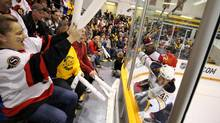 Fans react to a hit in the corner during the first period of the game between the Ottawa Senators and the Buffalo Sabres inside the JL Grightmie Arena in Dundas, On. - Kraft Hockeyville on Sept. 28, 2010. (Peter Power/Peter Power/The Globe and Mail)