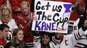 A fan of the Chicago Blackhawks holds up a sign that
