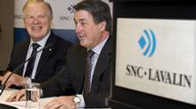 Jacques Lamarre, left, handed the reins of SNC-Lavalin to his successor, Pierre Duhaime, right, back in 2009. (Paul Chiasson/The Canadian Press)