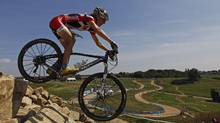 Canada's Catharine Pendrel competes in the Women's Cross Country Mountain Biking test event at Hadleigh Farm, east of London July 31, 2011. (Eddie Keogh/Reuters/Eddie Keogh/Reuters)