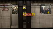 Commuters using the TTC subway in Toronto Mar. 26, 2012. (Moe Doiron/The Globe and Mail)