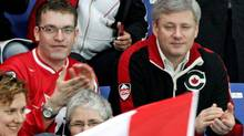 Prime Minister Stephen Harper takes in Canada's ice sledge hockey match against Italy during the 2010 Winter Paralympics in Vancouver on March 13, 2010. (DARRYL DYCK/THE CANADIAN PRESS)