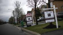 Houses with 'sold over asking' signs are seen in Mississauga, Thursday April 20, 2017. (Mark Blinch/Globe and Mail)