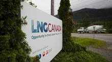 A truck drives past LNG Canada signage in Kitimat, British Columbia, Canada, on Friday, June 5, 2015. (Ben Nelms/Bloomberg)