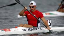 Canada's Adam van Koeverden reacts after competing in the men's kayak single (K1) 1000m heat at the Eton Dorney during the London 2012 Olympic Games August 6, 2012. (Reuters)