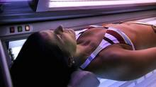 In this Wednesday, Dec. 14, 2005 file photo, a woman lies in a tanning booth in Anchorage, Alaska. International cancer experts have moved tanning beds and other sources of ultraviolet radiation into the top cancer risk category, deeming them as deadly as arsenic and mustard gas. The research was published online in the medical journal Lancet Oncology on Wednesday, July 29, 2009, by experts at the International Agency for Research on Cancer in Lyon, the cancer arm of the World Health Organization. (AL GRILLO/Al Grillo/AP)