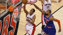 Toronto Raptors guard DeMar DeRozan, left, scores against New York Knicks centre Tyson Chandler, right, at Air Canada Centre in Toronto on Friday. (Tom Szczerbowski/USA Today Sports)