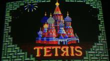 The beloved video game Tetris is 25 years old, but its opening page still honours its Russian roots, as seen here on an arcade screen in Brooklyn – though people today are more likely to be playing it on their cellphones. (Mark Lennihan)