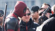 Canadian actor Ryan Reynolds, left, is seen on set during filming of the movie Deadpool on the Georgia Viaduct in Vancouver, B.C., on April 6, 2015. (DARRYL DYCK For The Globe and Mail)