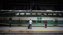 Passengers wait to board a GO train. (Fred Lum/The Globe and Mail)