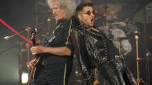 Adam Lambert, right, performs alongside Brian May of Queen. (Chris Pizzello/Invision/Associated Press)