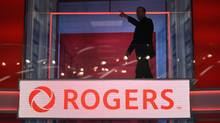 Guy Laurence, outgoing CEO of Rogers Communications, walks past the Rogers logo on the Hockey Central studio in 2015. Mr. Laurence's time at the company came to an abrupt end in October. (Fred Lum/The Globe and Mail)
