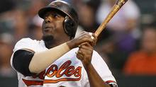 In this Aug. 13, 2011, file photo, Baltimore Orioles designated hitter Vladimir Guerrero hits a two-run home run in the second inning of a baseball game against the Detroit Tigers in Baltimore. The Toronto Blue Jays signed the 37-year-old to a minor league contract, which will start with an extended spring training program. (Patrick Semansky/AP)