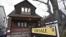 Data from the Toronto Real Estate Board show sales plunged 37.3 per cent in the GTA in June compared with the same month last year. (Fred Lum/The Globe and Mail)