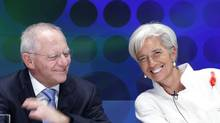 International Monetary Fund (IMF) Managing Director Christine Lagarde (R) laughs with Germany's Finance Minister Wolfgang Schaeuble before a seminar at the annual meetings of the IMF and the World Bank Group in Tokyo Oct. 12, 2012. (KIM KYUNG-HOON/REUTERS)