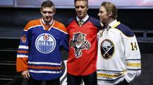 From left, Edmonton Oilers' Leon Draisaitl, Florida Panthers' Aaron Ekblad and Buffalo Sabres' Sam Reinhart pose for photographs during the first round of the NHL hockey draft, Friday, June 27, 2014, in Philadelphia. (Matt Slocum/AP)
