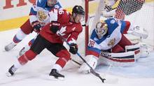 Team Canada centre Jonathan Toews (16) closes in on Team Russia goaltender Sergei Bobrovsky during first period semifinal World Cup of Hockey in Toronto, September 24, 2016. (Frank Gunn/THE CANADIAN PRESS)