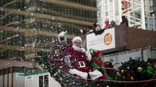 Santa Claus waves to spectators as the 9th annual Rogers Santa Claus Parade makes its way along West Georgia Street in downtown Vancouver, British Columbia, Sunday, December 2, 2012. More than 3,500 participants, including 60 marching bands, choirs, festive floats, and community groups took part in this year's parade. (Rafal Gerszak For The Globe and Mail)
