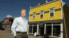 Glynn Williams sits on the road outside of his pub, microbrewery and café in Guysborough, N.S. Mr. Williams, a self-described serial entrepreneur, has been investing into the small seaside community. (PAUL DARROW For The Globe and Mail)