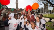 The author brought a group of school children to the British Parliament last year to promote his call for making practical food education a compulsory subject on the curriculum of G20 countries. (LEON NEAL/AFP/Getty Images)