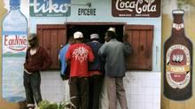 Customers queue at a makeshift bar in Antananarivo, Madagascar on March 21, 2009. (Siphiwe Sibeko/REUTERS)