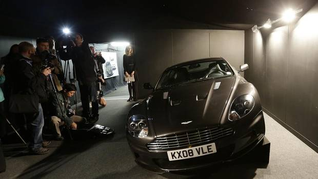 The 2008 Aston Martin 6 litre V12 DBS 2 door coupe used by Daniel Craig as James Bond in the movie 'Quantum of Solace' is shown to the media during a press preview at the James Bond movie memorabilia charity auction at Christie's auction house in London.