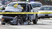 A Royal Canadian Mounted Police truck sits smashed up at a crime scene where a gunman was killed and three RCMP officers were injured, according to local media, in St. Paul, Alta., on May 10. (Amber Bracken/Reuters)