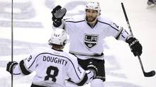 Los Angeles Kings' Drew Doughty (8) celebrates his goal with teammate Jarret Stoll during the first period of Game 2 of the NHL Western Conference hockey finals against the Phoenix Coyotes in Glendale, Arizona, May 15, 2012. (Todd Korol/Reuters/Todd Korol/Reuters)