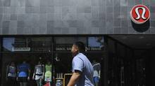 A man walks in front of a Lululemon location in downtown Toronto. (Fred Lum/The Globe and Mail)