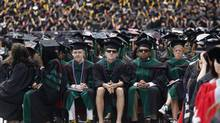 A student in flip flops and shorts at a spring commencement ceremony at Ohio State University. (JASON REED/REUTERS)