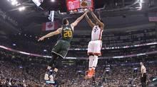 Gordon Hayward of the Utah Jazz, left, fails to block a jump shot from the Raptor's DeMar DeRozan at Air Canada Centre in Toronto on Thursday. (Dan Hamilton/USA Today Sports)