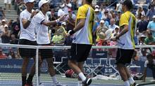 Vasek Pospisil (L) and Daniel Nestor of Canada congratulate Mike (L) and Bob Bryan of the U.S. after the Bryan brothers won their doubles match at the U.S. Open tennis championships in New York September 1, 2013. (EDUARDO MUNOZ/REUTERS)