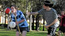 In a picture taken on June 26, 2011 chaser Jacob Warnock (L) is hit by a bludger throwing opponent (R) while training for Muggle Quidditch, based on J.K Rowling's 'Harry Potter' books and films, in Sydney. (Torsten Blackwood / AFP / Getty Images/Torsten Blackwood / AFP / Getty Images)
