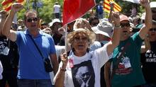 Supporters of miners protest against government austerity measures in Madrid July 11. (ANDREA COMAS/REUTERS)
