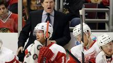 Detroit Red Wings head coach Mike Babcock, top, yells his team during the first period of Game 1 of an NHL playoffs Western Conference semifinal against the Chicago Blackhawks in Chicago, Wednesday, May 15, 2013. (Nam Y. Huh/AP)