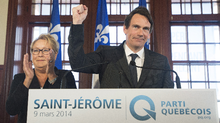 Parti Québécois leader Pauline Marois looks on as Pierre-Karl Péladeau gestures during a press in Saint-Jérôme, Que., Sunday, March 9, 2014. Mr. Péladeau has announced his candidacy for the riding of Saint Jerome for the Parti Québécois on day five of the Quebec provincial election campaign. (Graham Hughes/THE CANADIAN PRESS)